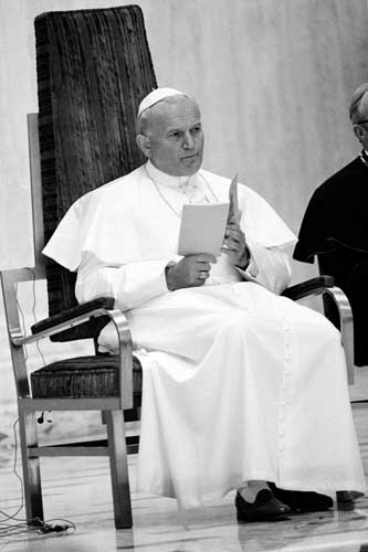 Pope John Paul II looks up from a program during a service in Quigley Seminary Chapel on Chigao&#39;s South Side before meeting with Catholic bishops, Friday, Oct. 5, 1979. <span class=meta>( &#40;AP Photo&#41;)</span>